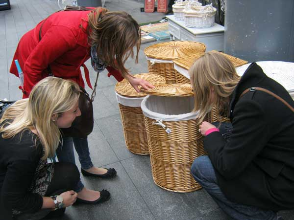 Three women looking for a clue in a basket.