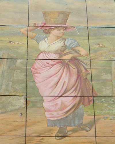 A wall painting showing an 18th century milkmaid.