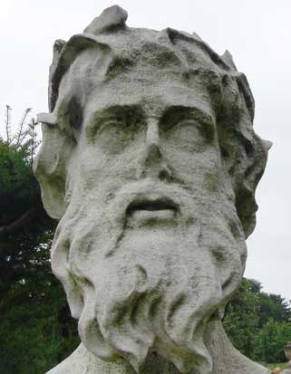 A carved stone face in the grounds of Chiswick House .
