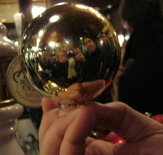 A team member holds a Christmas decoration.
