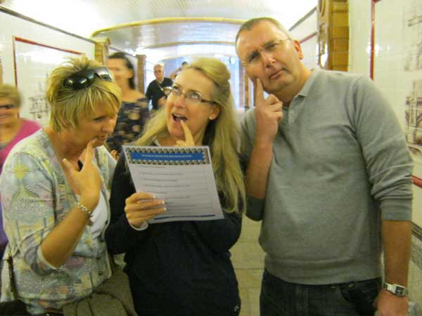 Three people thinking about a clue on the London Bridge Treasure Hunt.