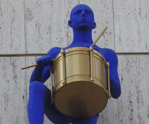 The blue figure playing a drum that appears at some point on the treasure hunt.