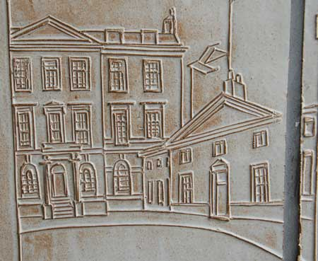 A carving of a street scene in Mayfair.