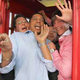 A trreasure hunt team inside a phone box as one of their challenges.