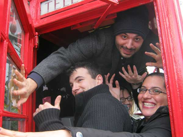 A team posing in a phone box as part of their South Bank Treasure Hunt.