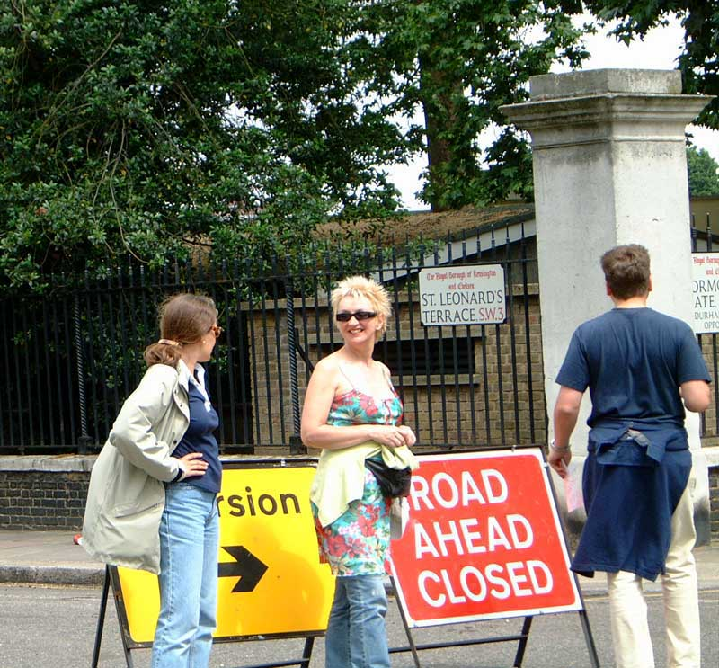 People stopping by a Road Closed sign on the Chelsea Treasure Hunt.