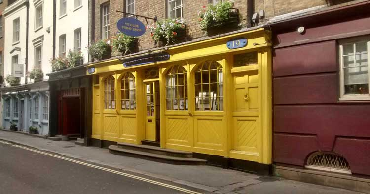A yellow shop that appears on the Seven Dials Treasure Hunt.