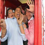 A treasure hunt team squeezes into a London phone box.