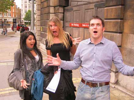 Three people acting surprised as one of their pose challenges.