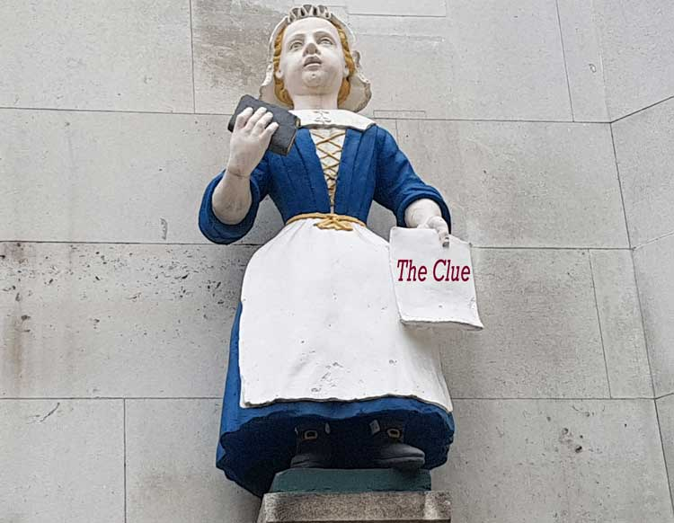 The statue of a charity girl wearing a blue dress and white apron that forms one of the treasure hunt clues..