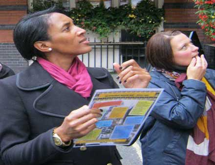 Two people looking for a clue on a London treasure hunt.