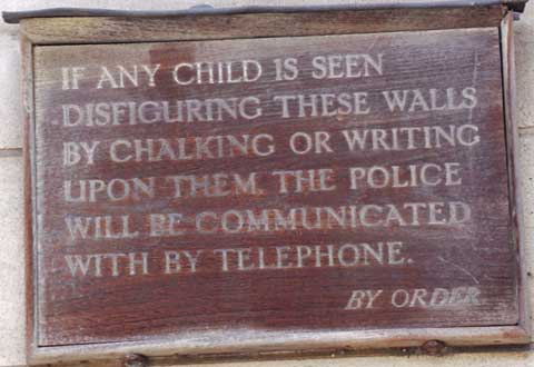 A sign warning against chalking or writing on the wall.